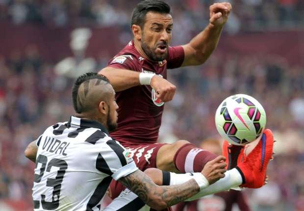 Torino striker Fabio Quagliarella and Arturo Vidal of Juventus