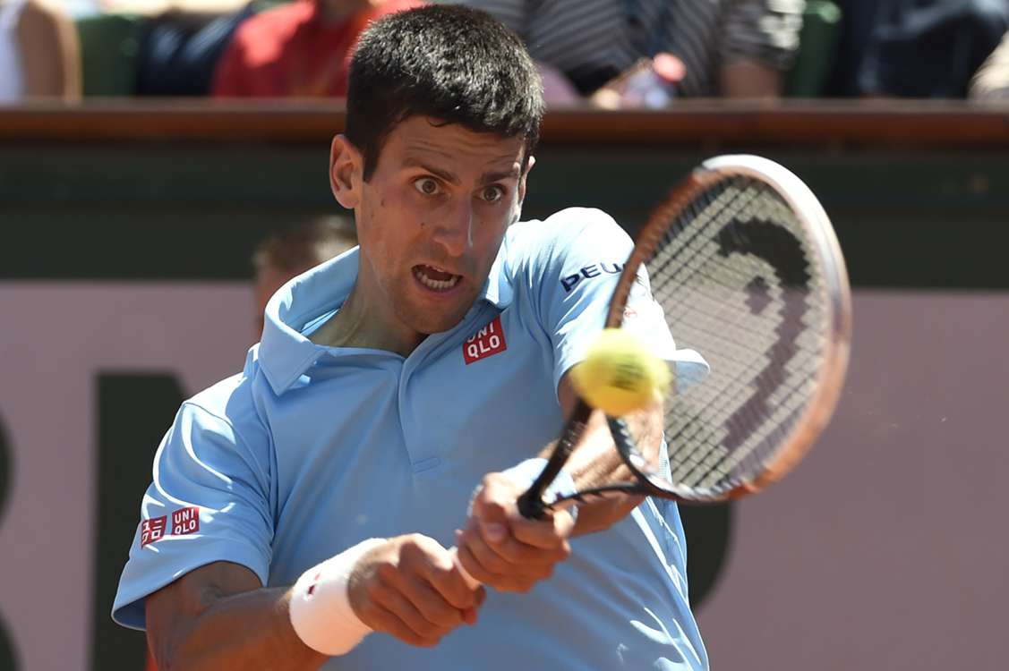 Djokovic books French Open final place
