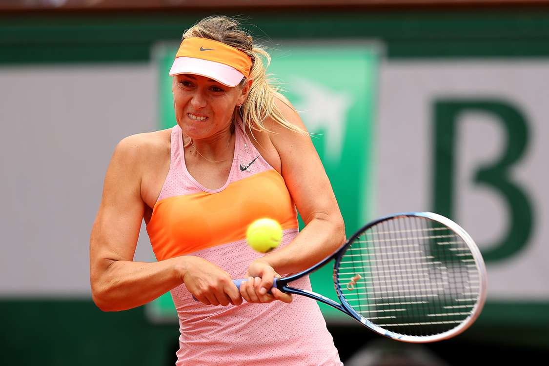 Sharapova fights back to reach last four