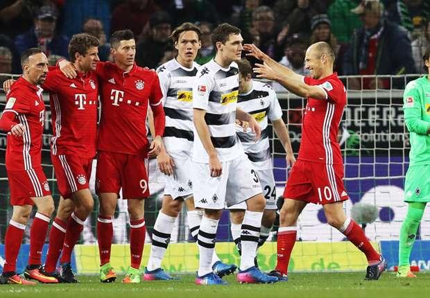 Bayern Munich celebrate Thomas Muller's opener against Borussia Monchengladbach