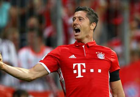 Lewy scores three in Bayern rout