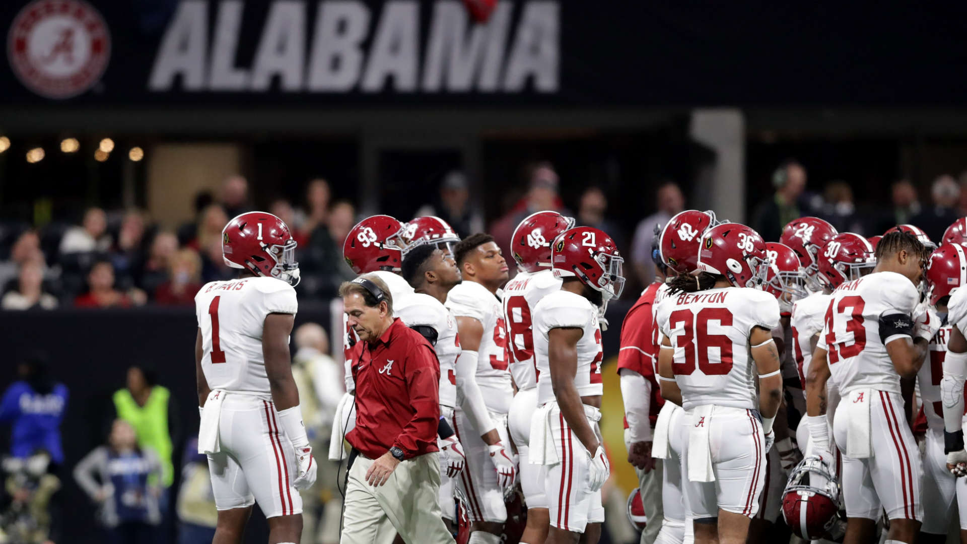 Alabama's Kyriq McDonald collapses on sideline during national championship game