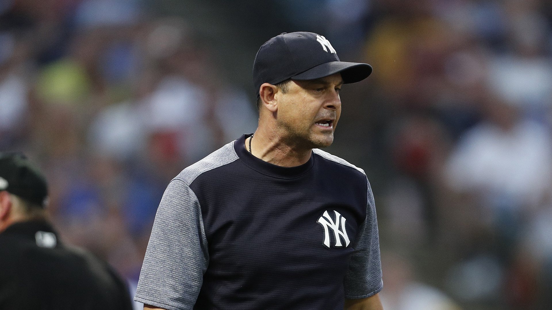 WATCH: Aaron Boone gets ejected, squats like catcher to show umpire strike zone