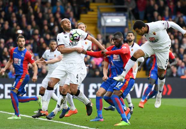 Watford striker Troy Deeney scores an own goal versus Crystal Palace