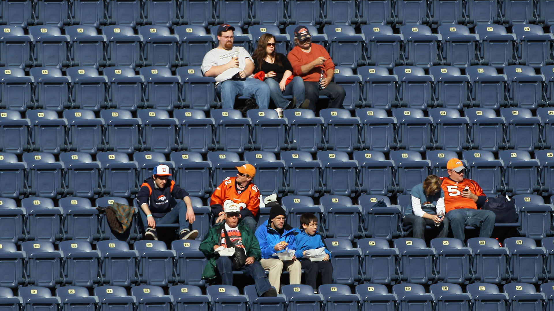 Empty seats at a Broncos-Texans game
