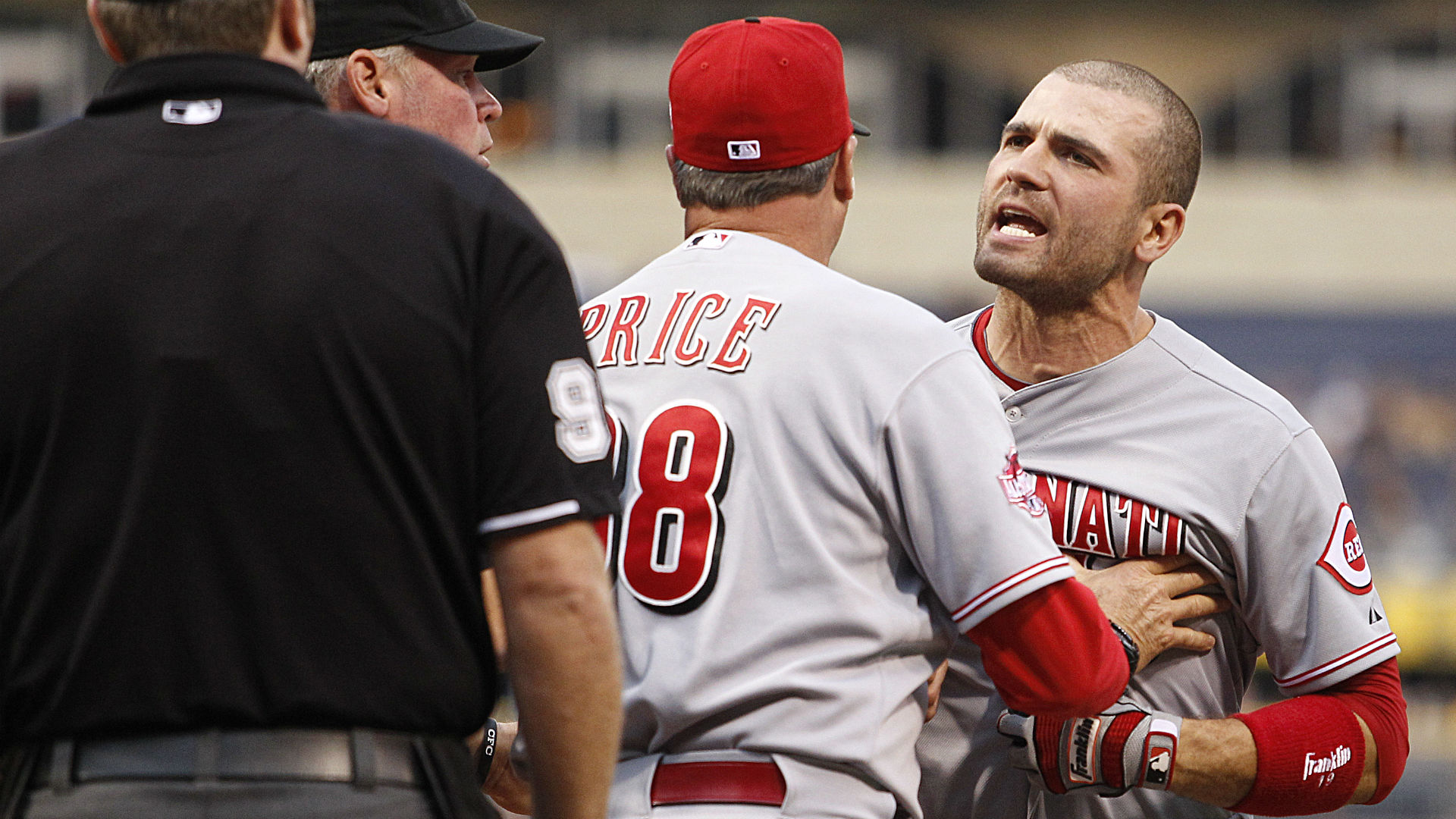 Joey Votto charges ump, makes contact during post-ejection ...