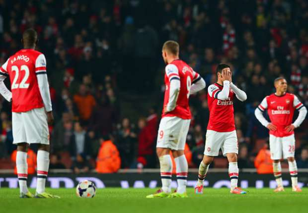 Arsenal 'million miles away' from title, says Scholes