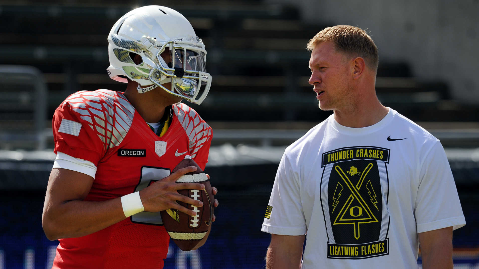 Scott Frost, right, with Marcus Mariota