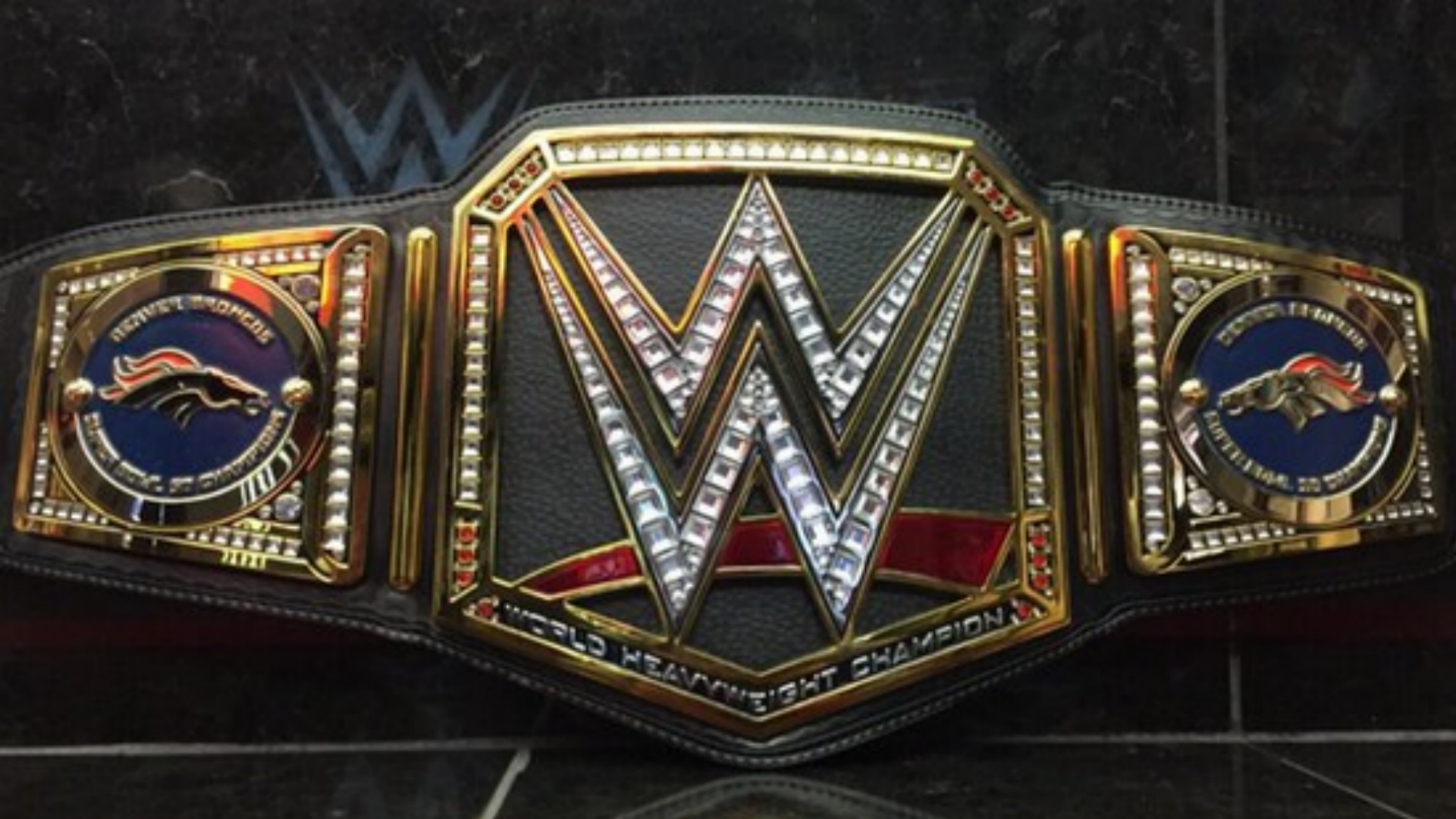 ... Triple H Broncos Belt 020816 Usnews Getty Ftr