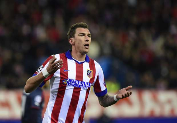 Atletico Madrid 4-0 Olympiakos: Mandzukic hat-trick fires hosts into next round
