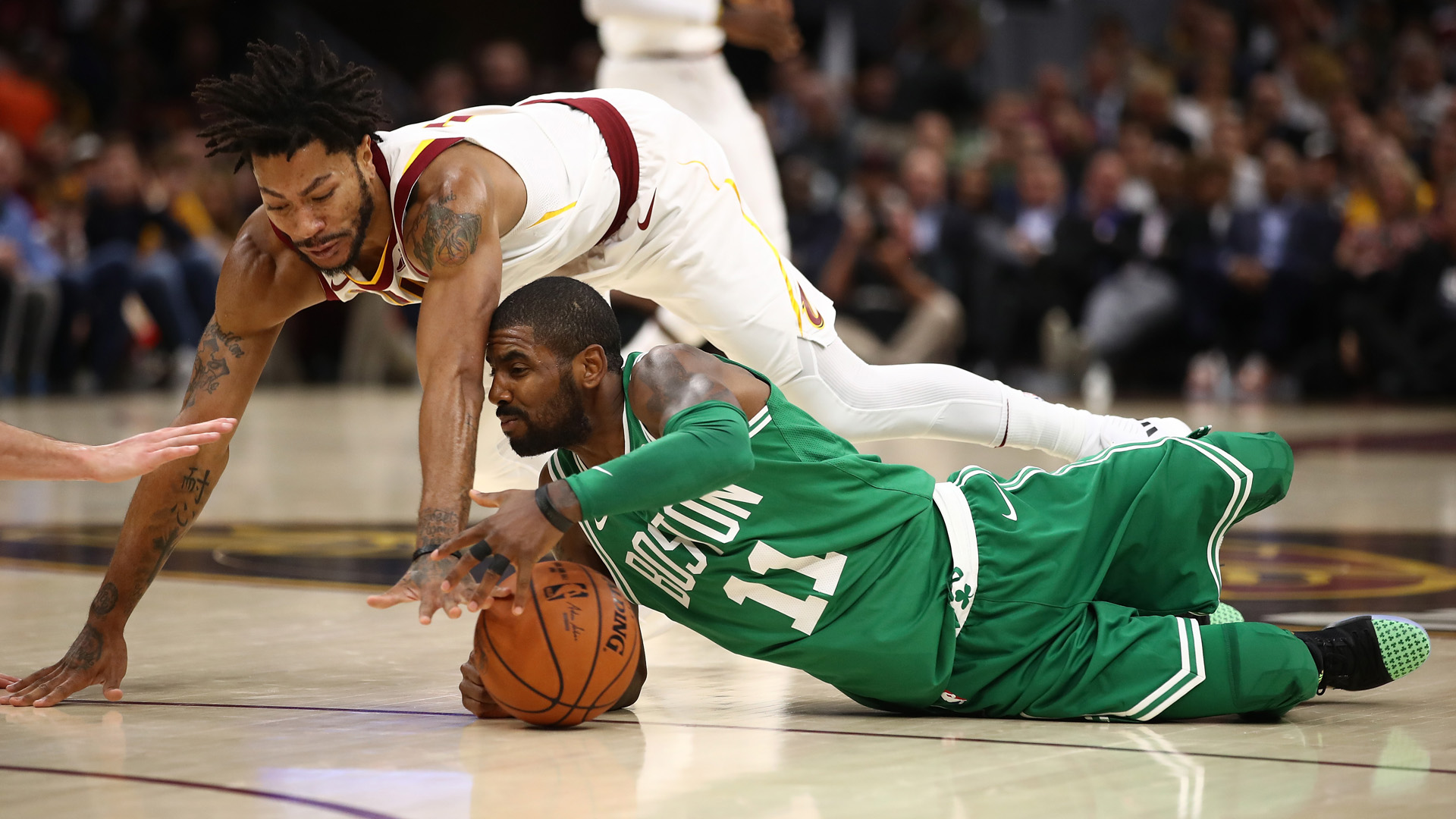 Kyrie-irving-right-and-derrick-rose-left_18w6iusht64x718ad85du7apt6