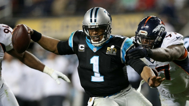 Cam Newton (1) chased by Malik Jackson