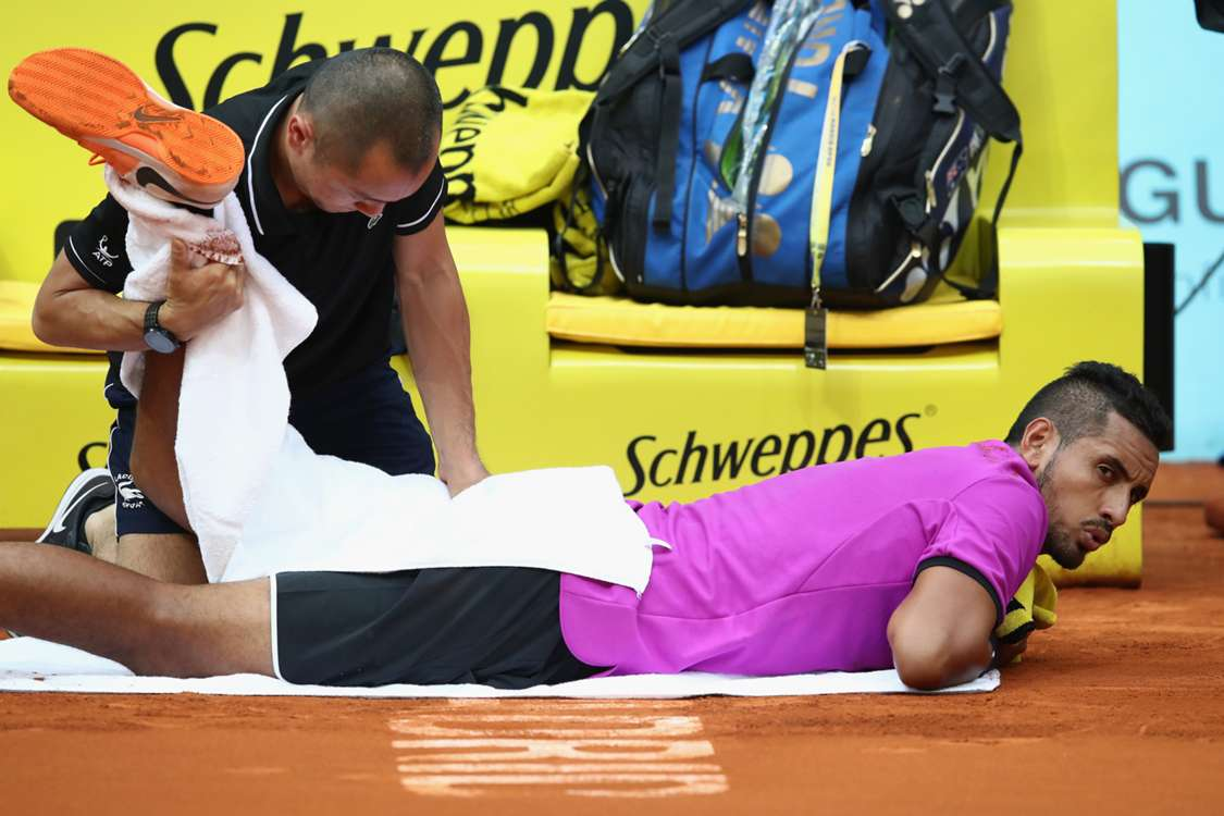 Injured Kyrgios gets the job done in Madrid