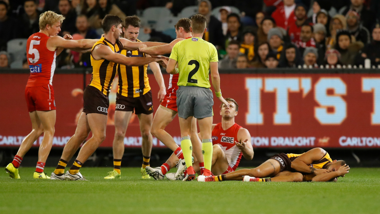 Sydney star Luke Parker cleared over bump on Hawthorn's Jarman Impey