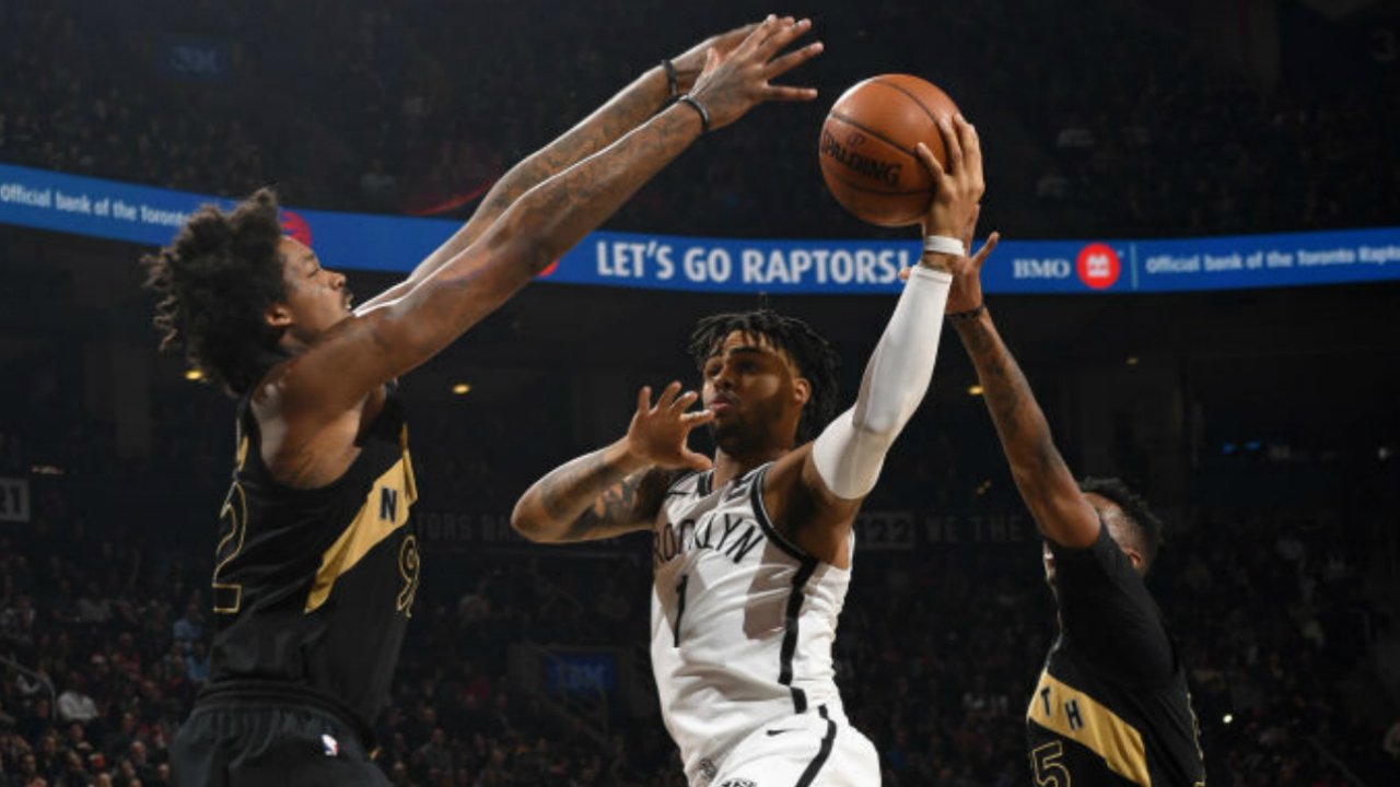 Raptors top Nets on Lowry's triple-double