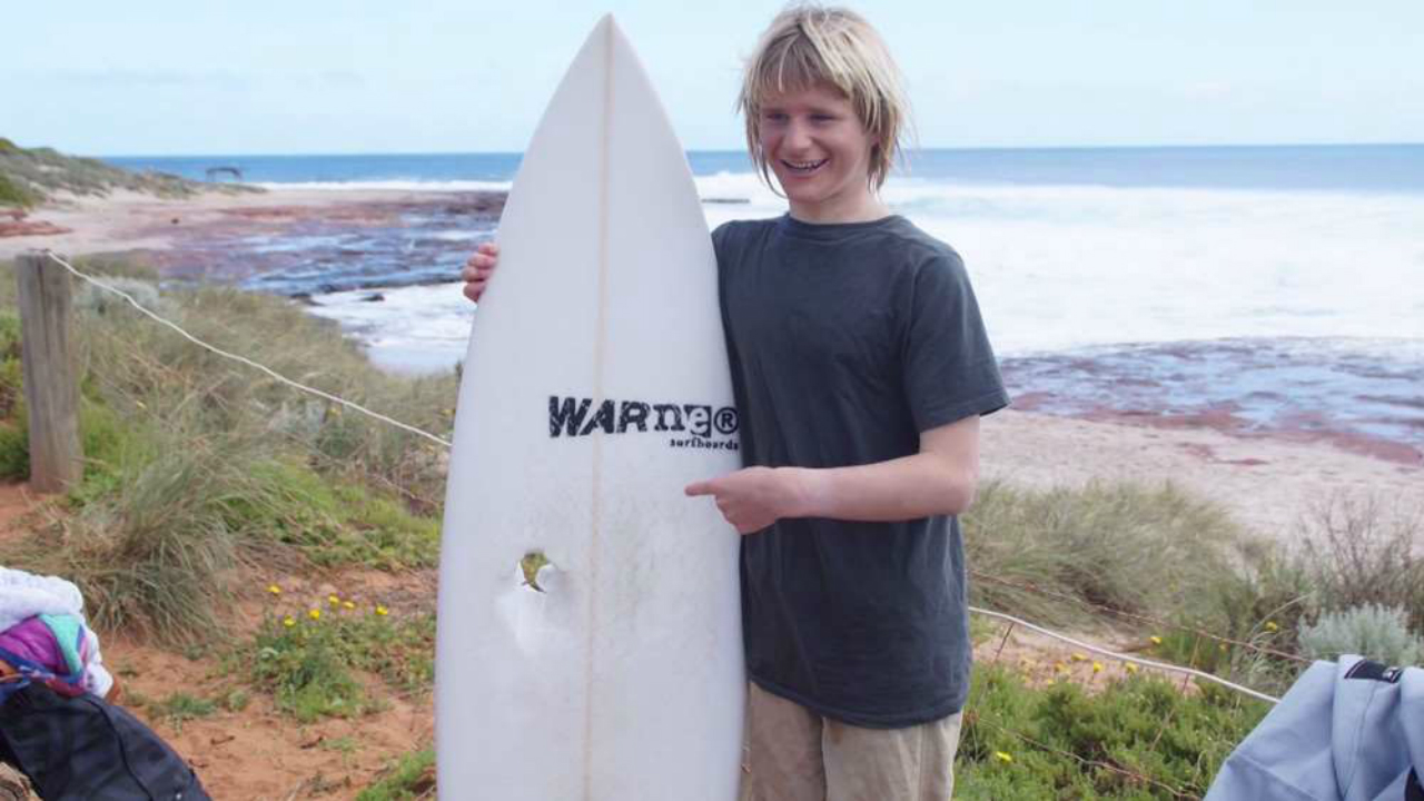 Dolphin totals surfer: Teen slammed by wave-catching bottlenose