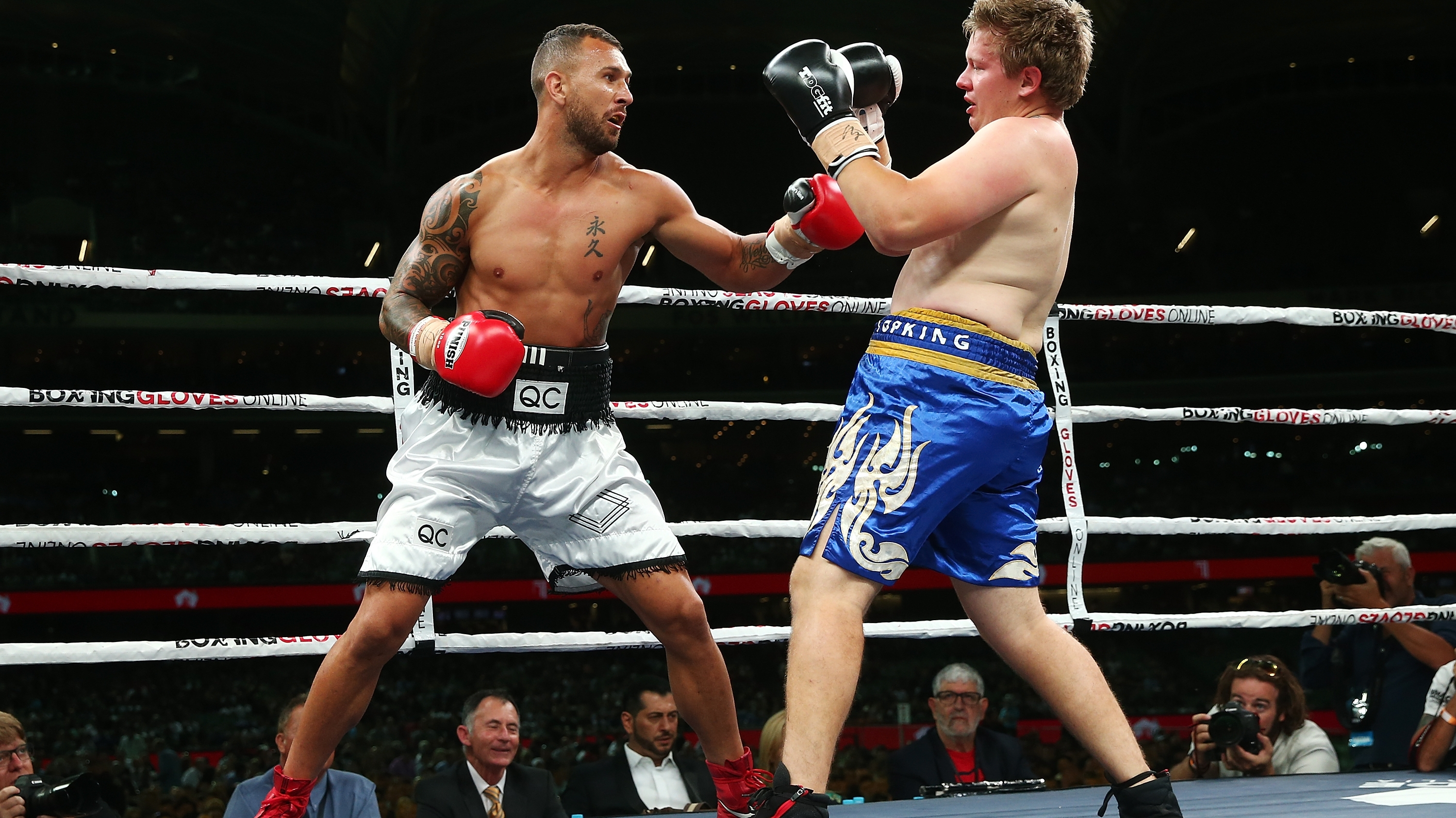 Rugby star Quade Cooper wins third professional fight with ...
