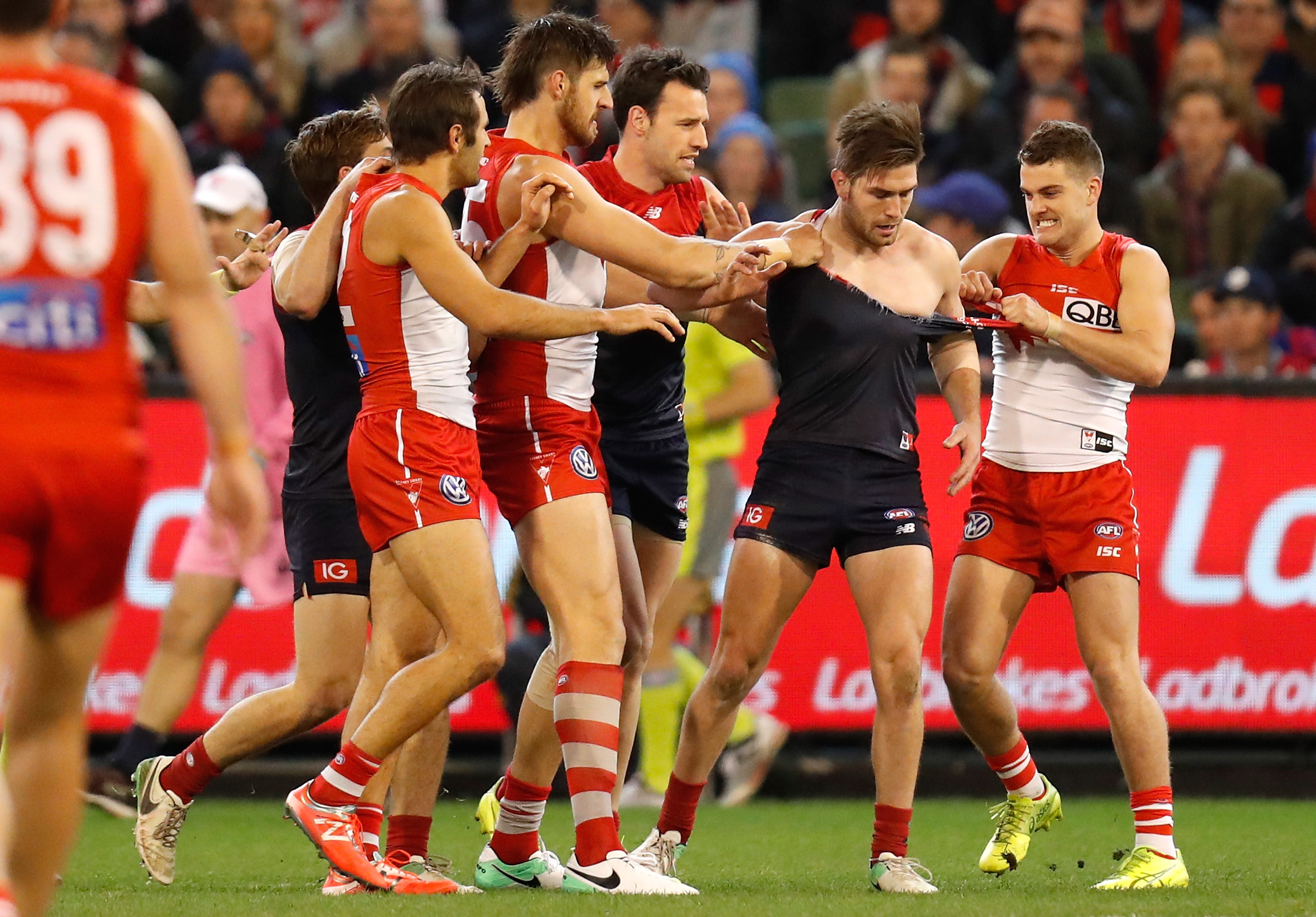 'Embarrassed' Bugg apologises for Mills punch