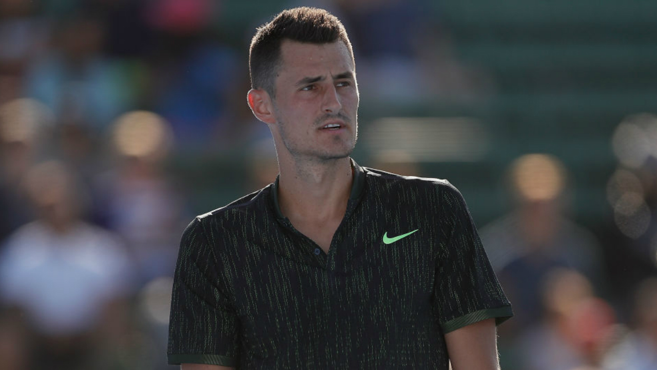 Bernard Tomic is digging himself a big hole, claims Lleyton Hewitt