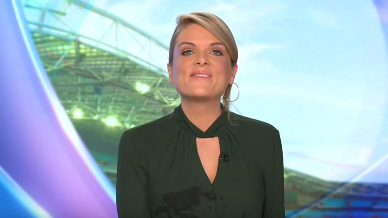 Footy Show presenter Erin Molan falls of chair during news bulletin
