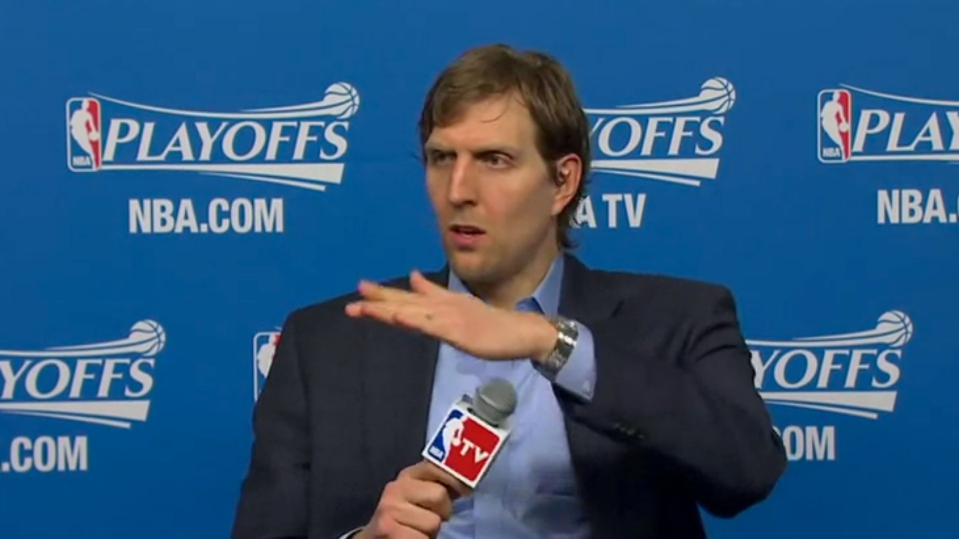 Dirk Nowitzki gets violent with a microphone