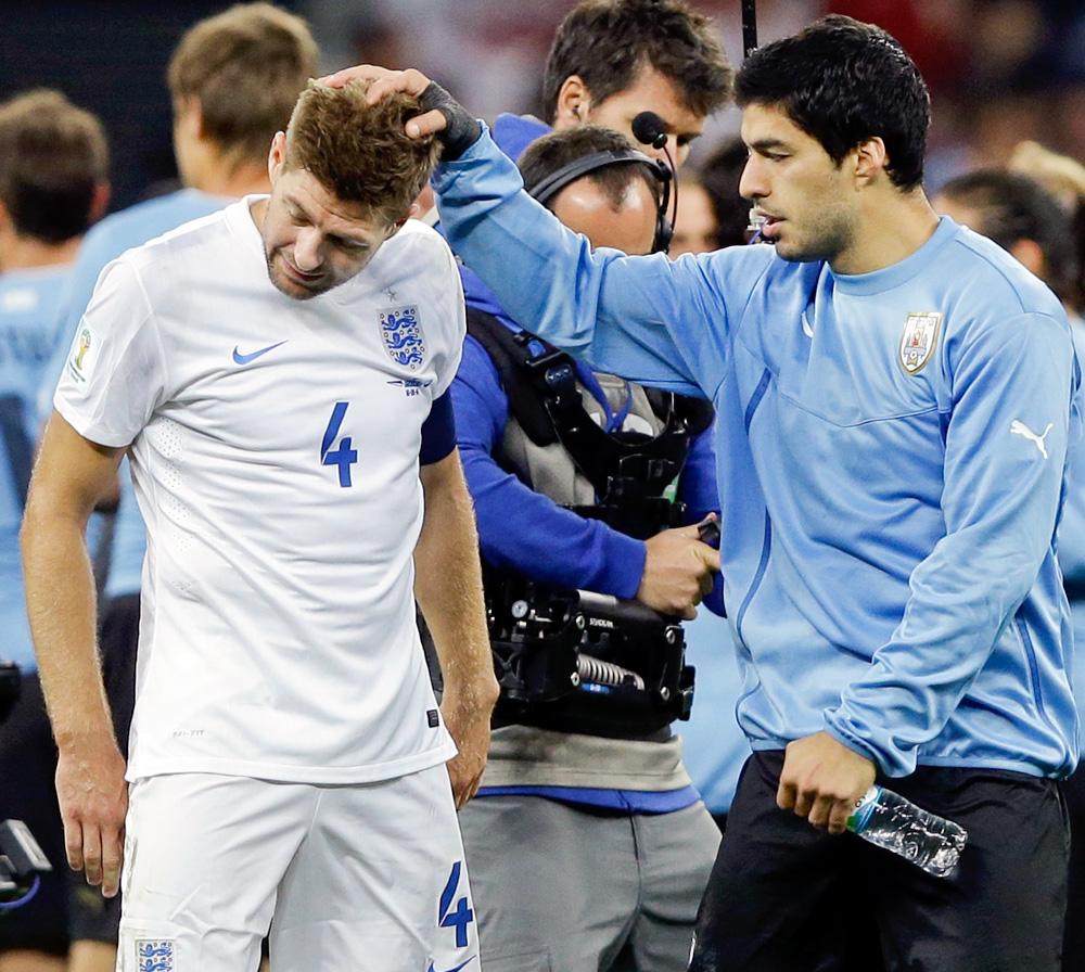 Luis Suarez and Steven Gerrard-061914-AP-DL.jpg