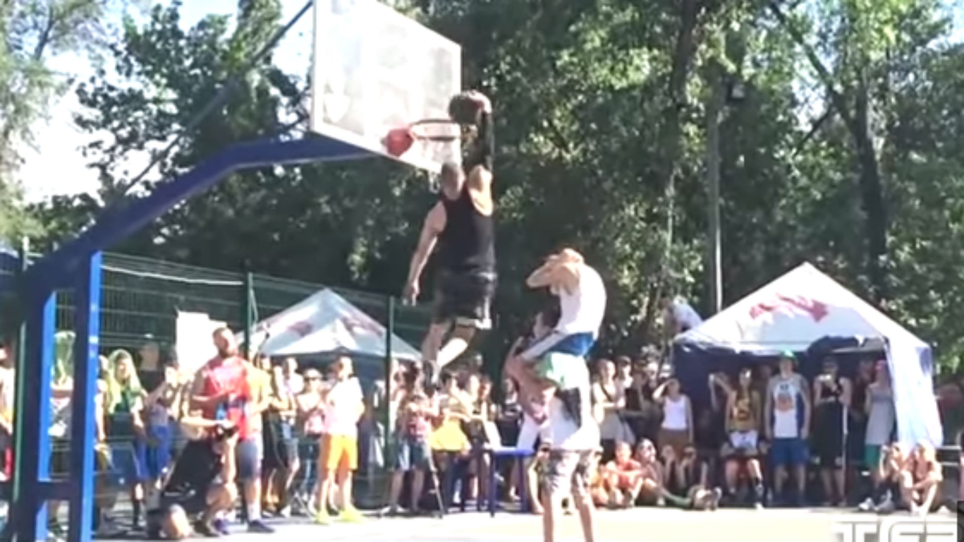A 5-9 dunker jumps over two people for 'Triple Up' throwdown