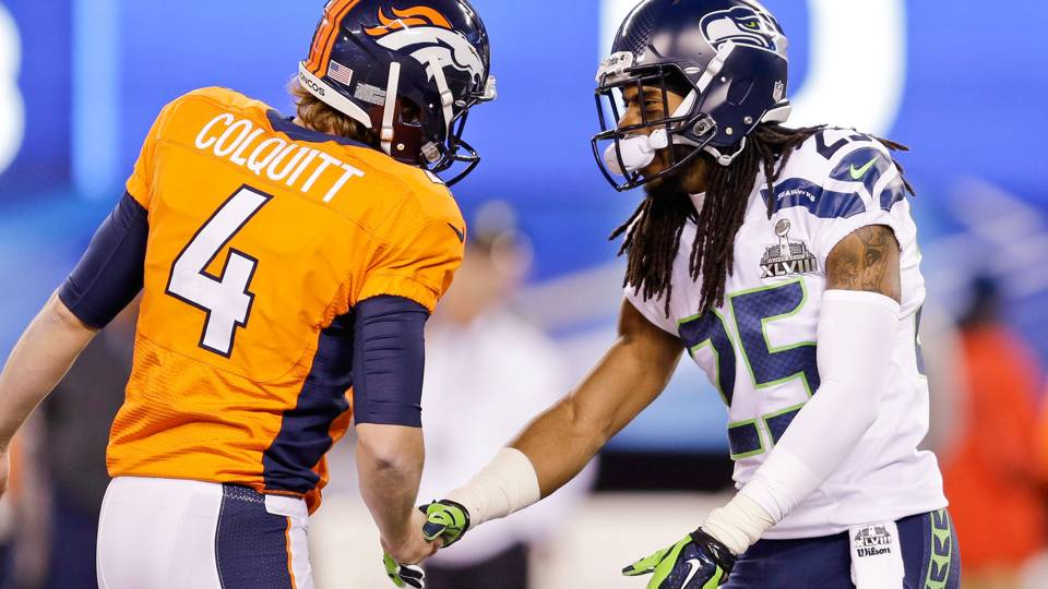 Richard Sherman and Britton Colquitt-020214-AP-FTR.jpg