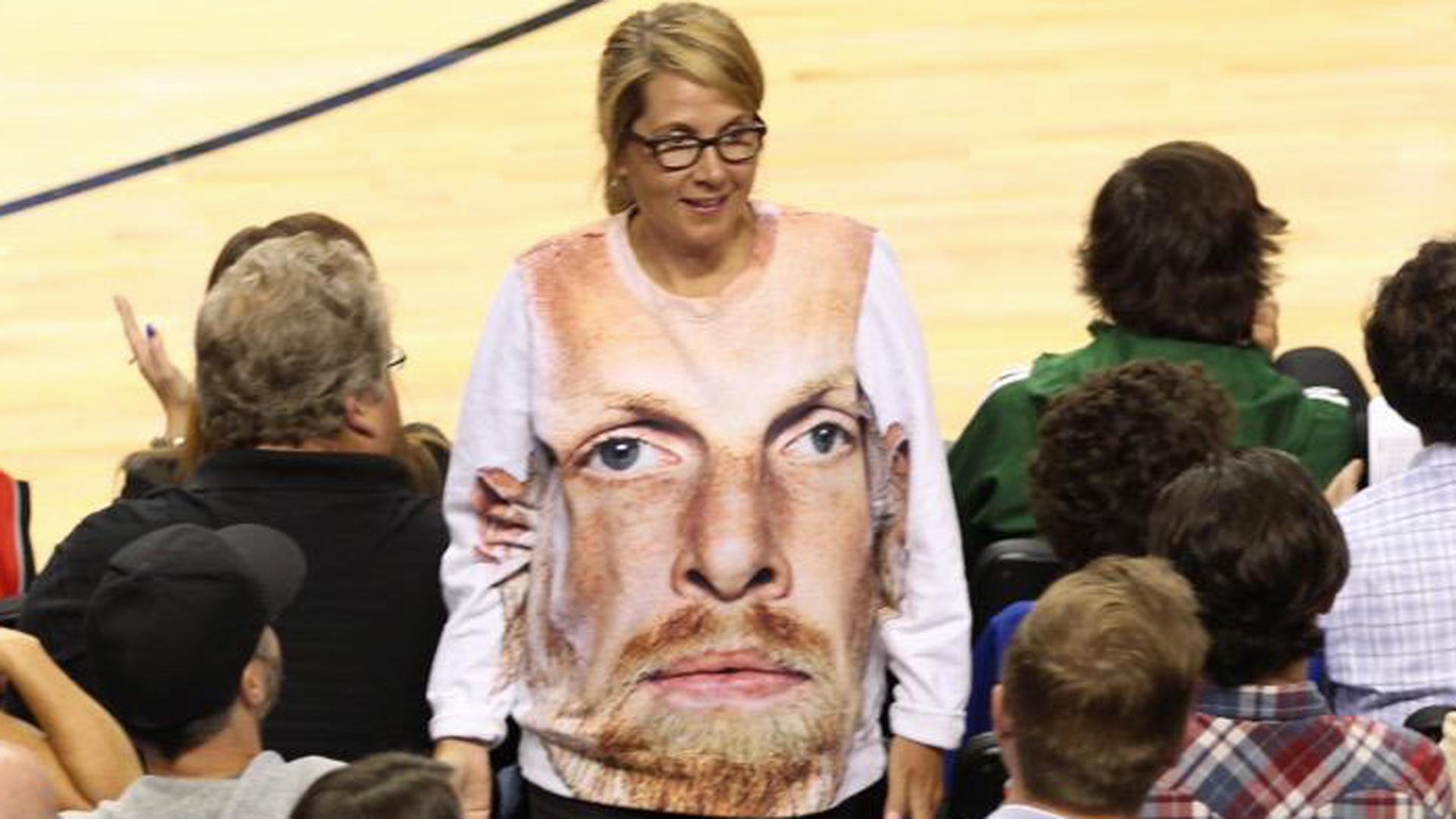 This Blazers fan has a sweater with Chris Kaman s giant face on it