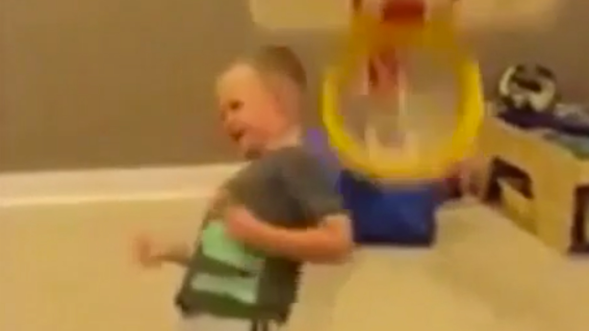 Small child learns valuble life lesson about post-dunk celebration