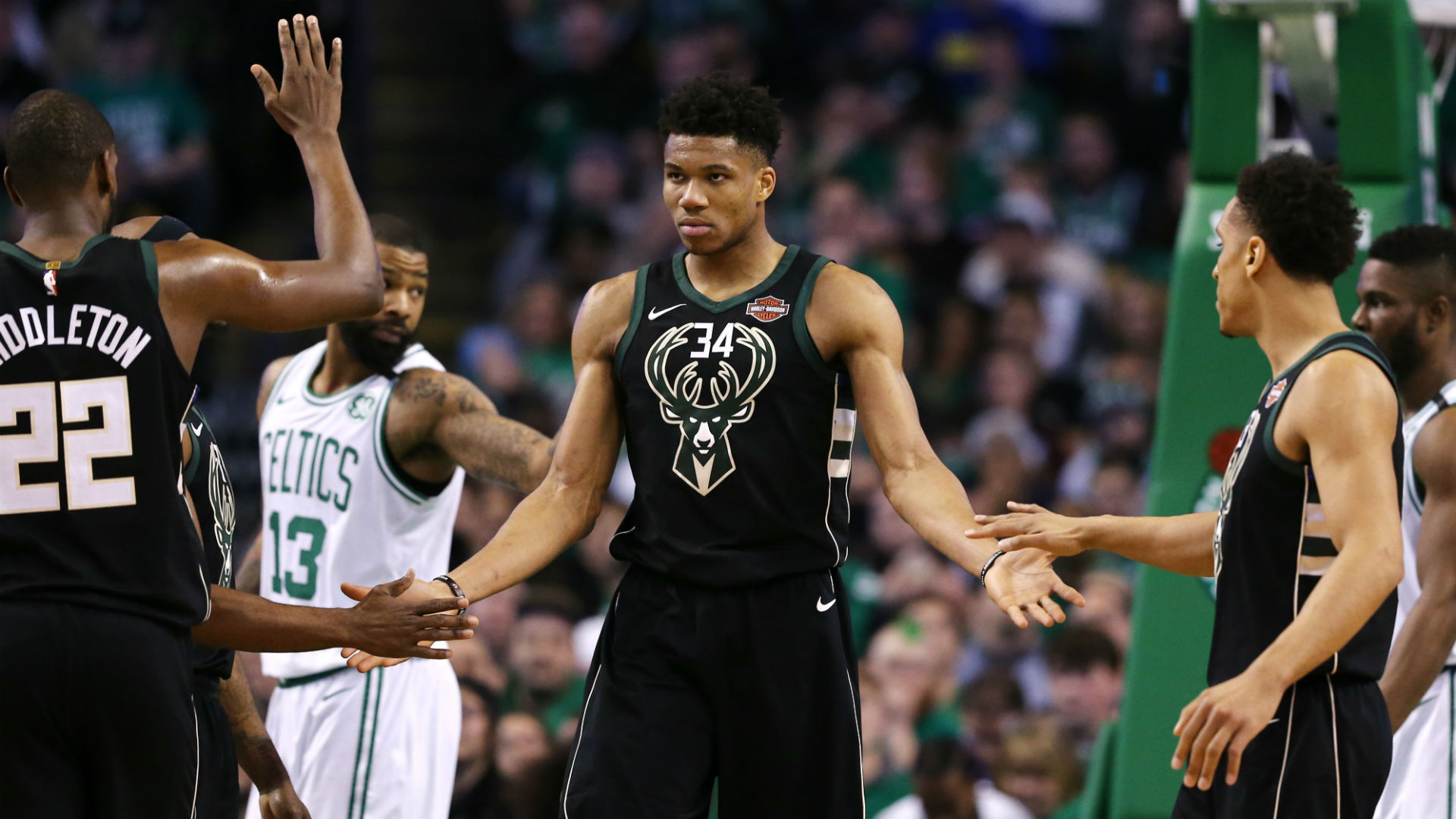 Irving, Celtics hand Bucks first loss of year