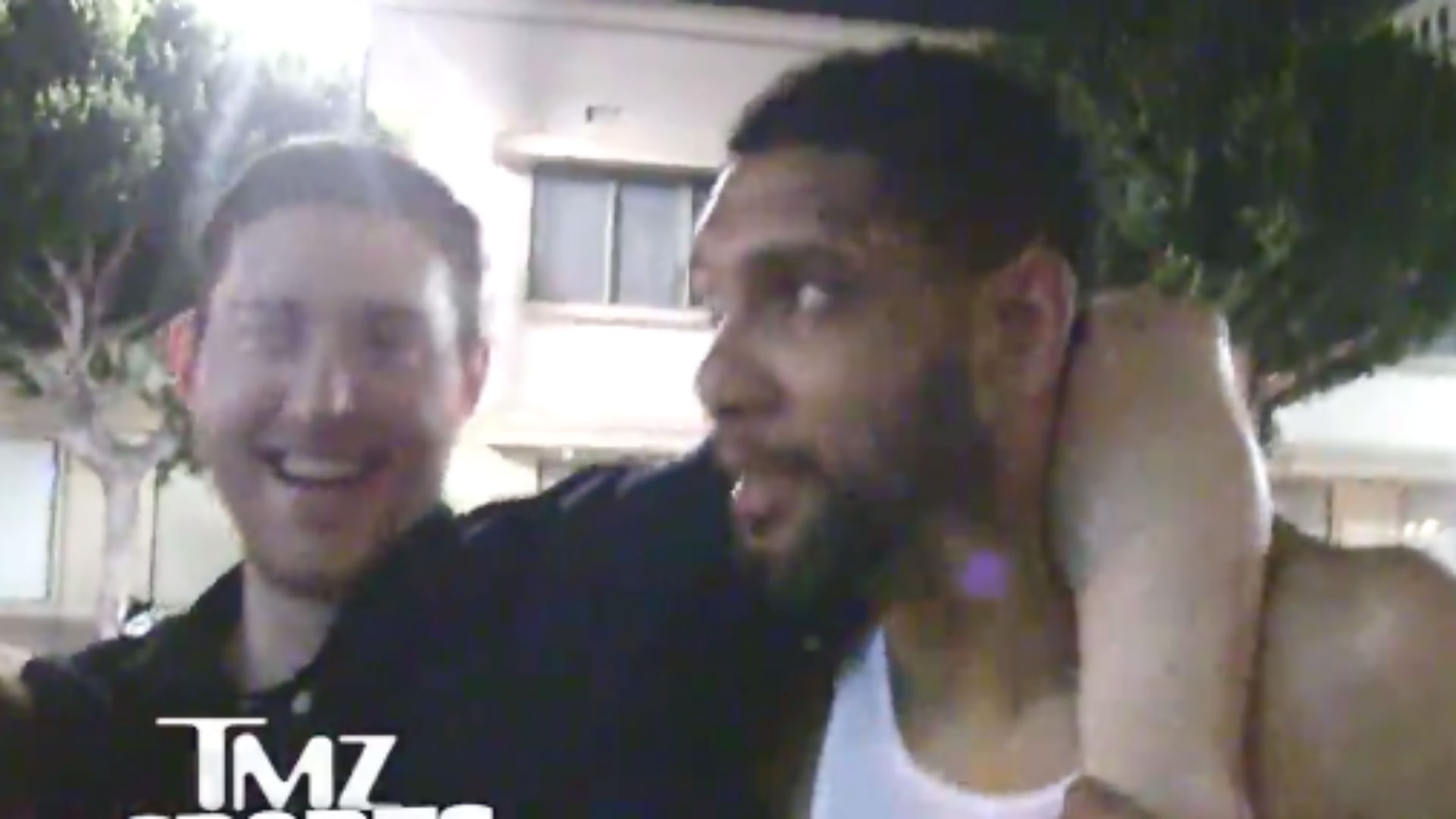 Tim Duncan carries Aron Baynes out of a club after Game 7 loss