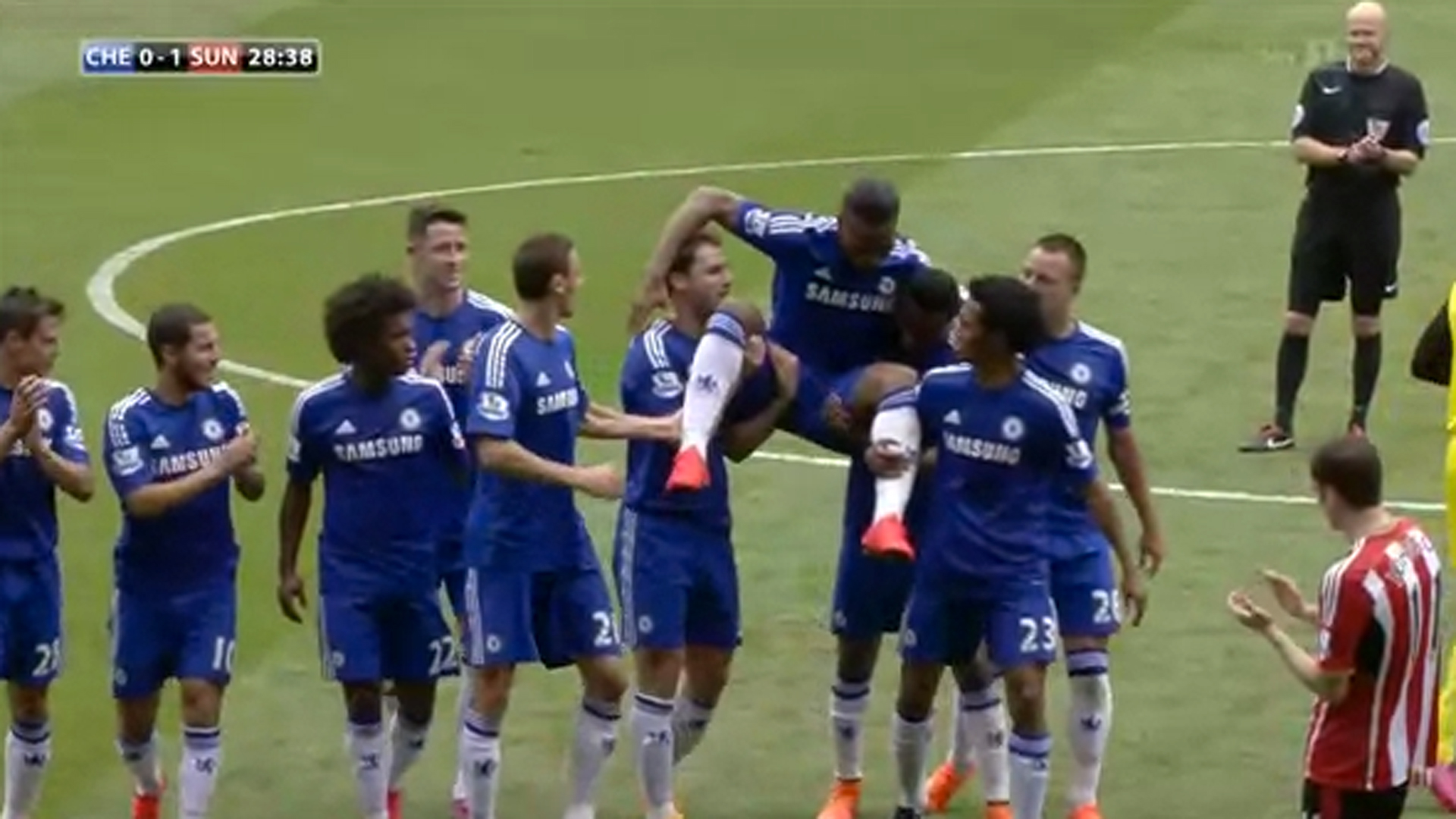 Chelsea teammates carry Didier Drogba off the field in his final match