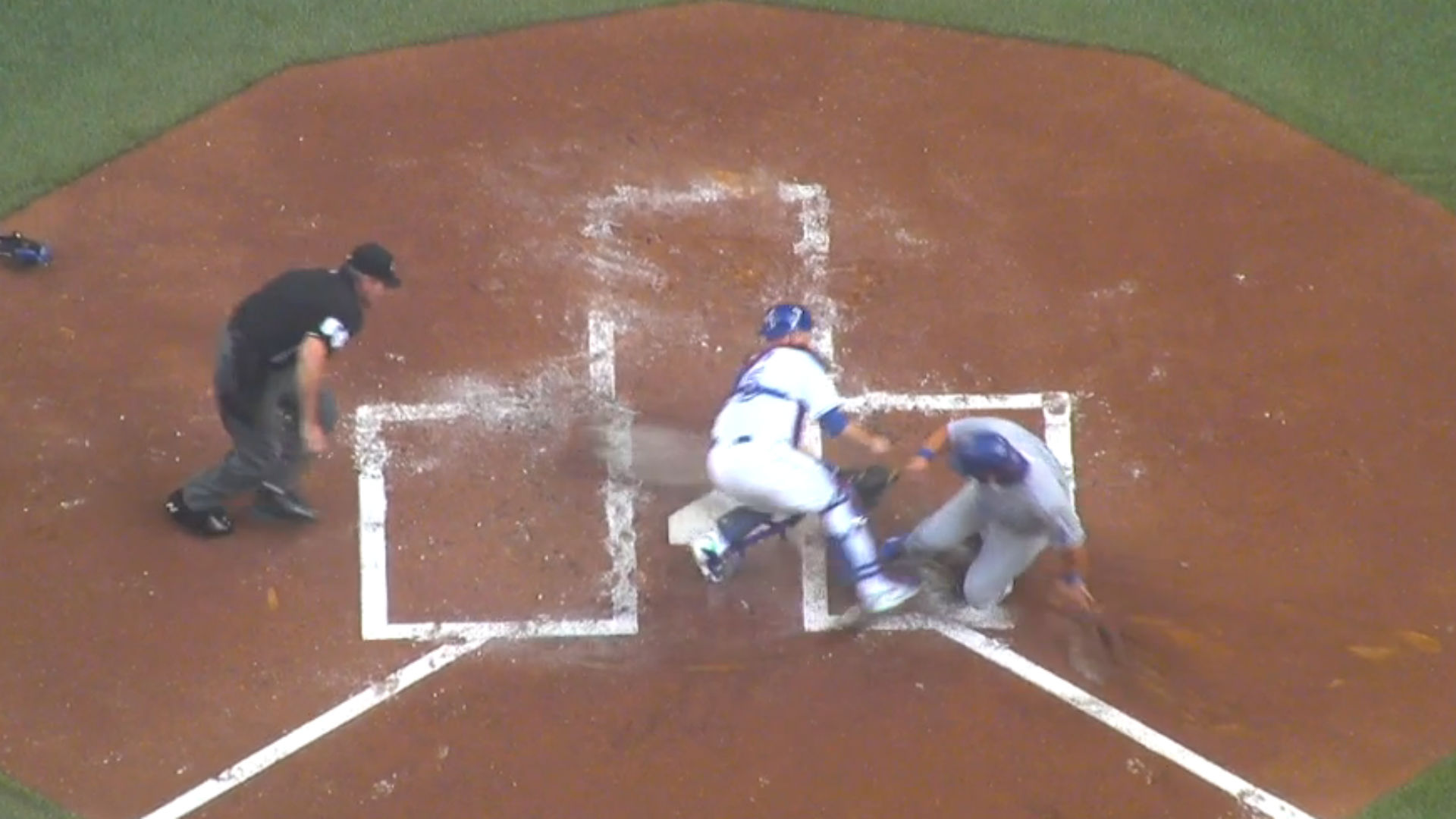 Royals' Kendrys Morales avoids out with slick slide into home plate