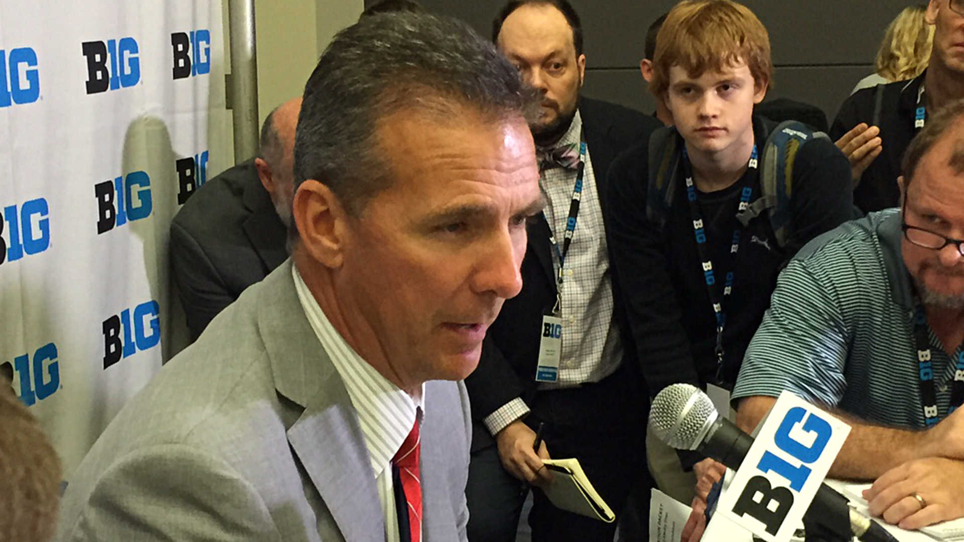 Urban Meyer relaxed in front of quarterback, suspension questions