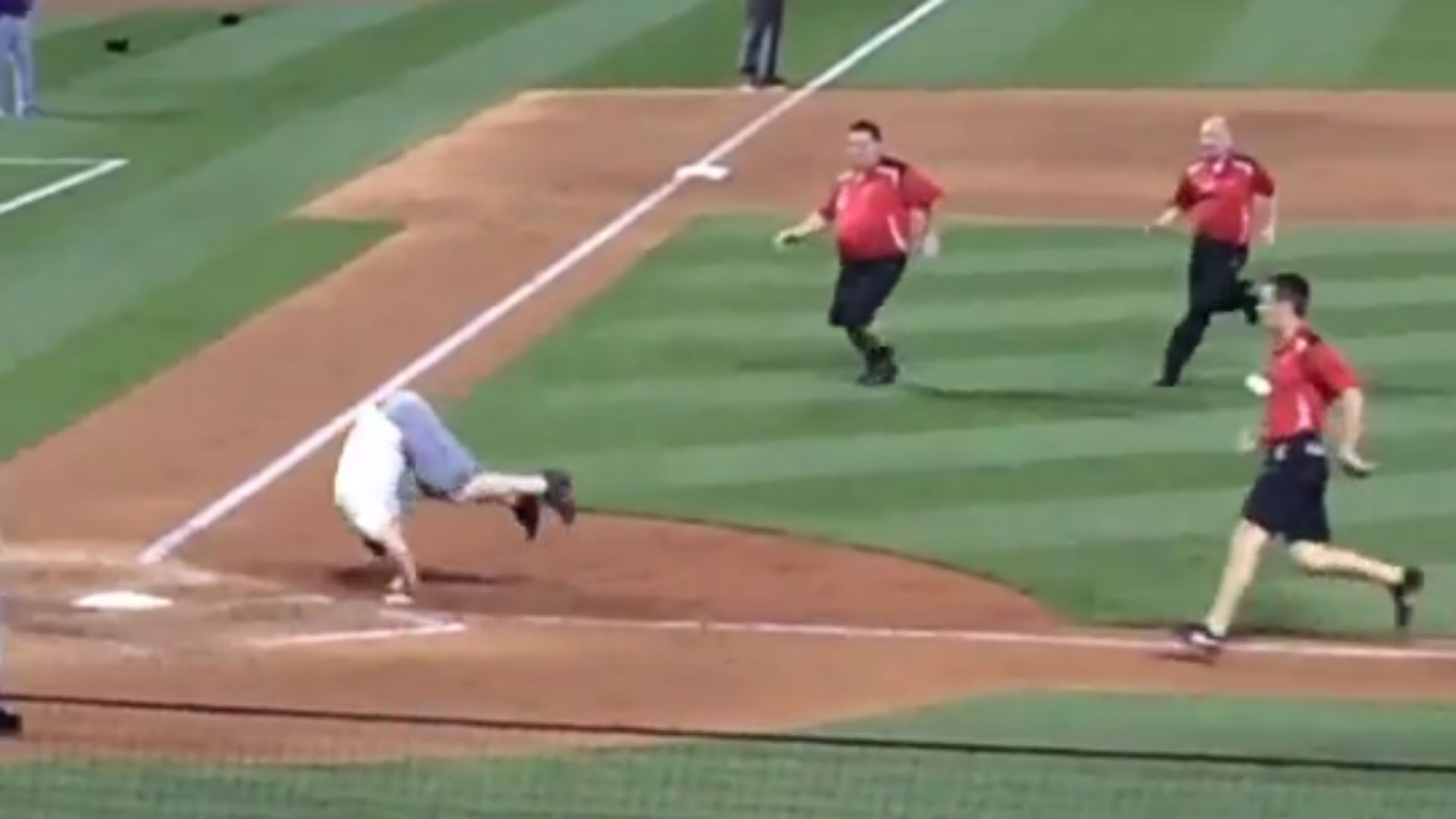 Cardinals fan beats security to somersault on home plate