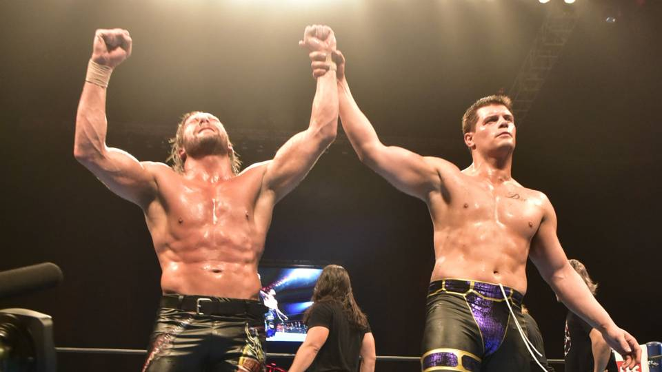 Kenny Omega and Cody raising arms after G1 special
