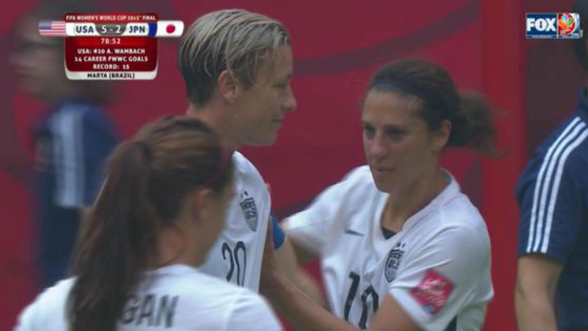Carli Lloyd hands off captain's armband to Abby Wambach