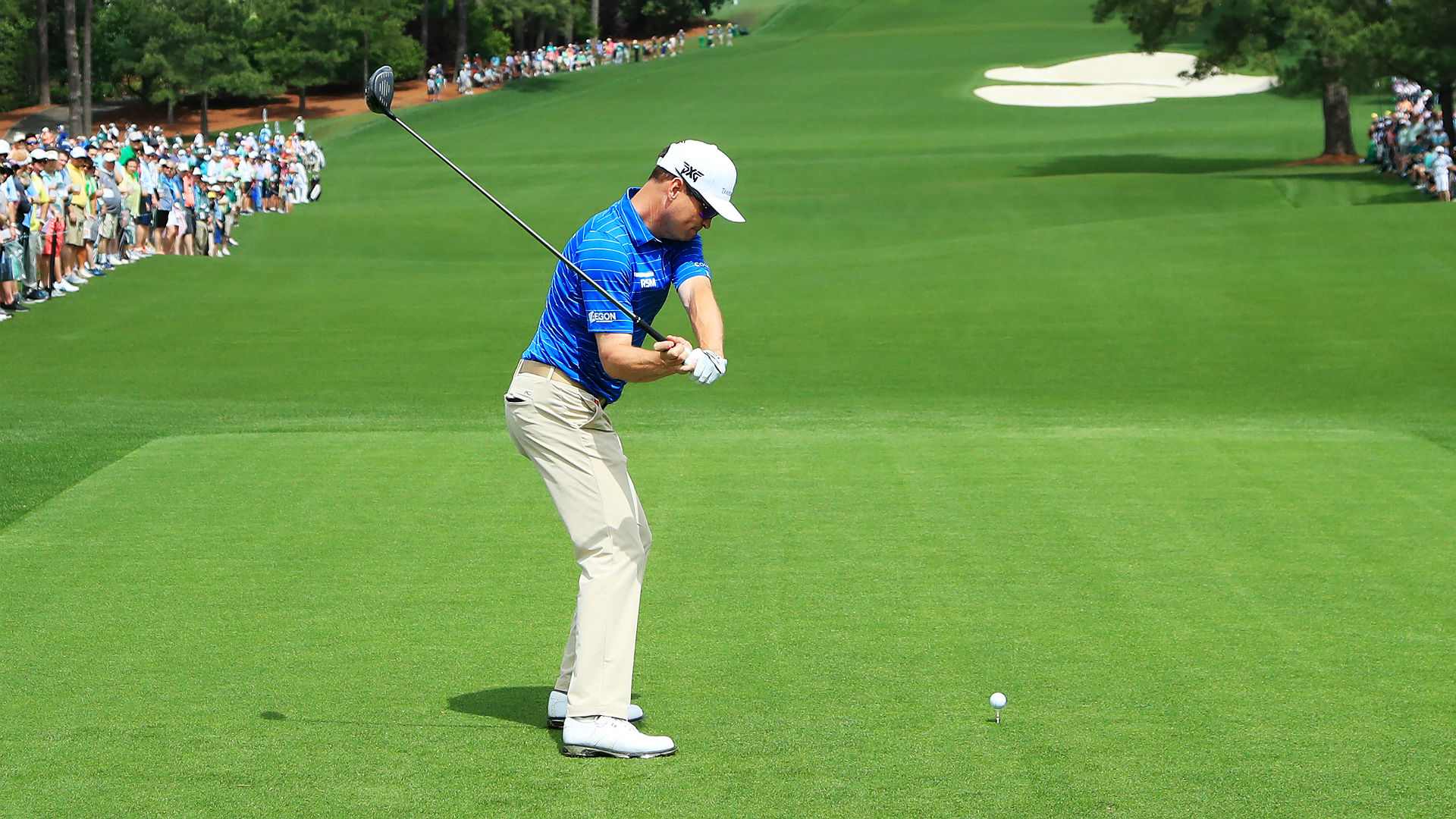 Zach Johnson knocks ball off tee with practice swing at the Masters