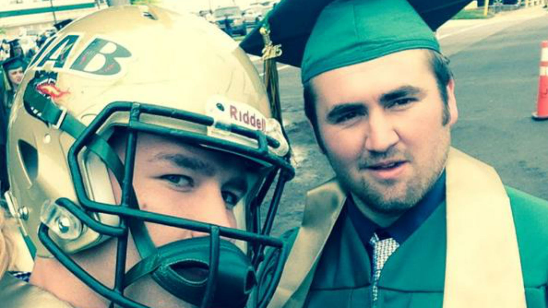 Former UAB linebacker protests by wearing helmet to graduation