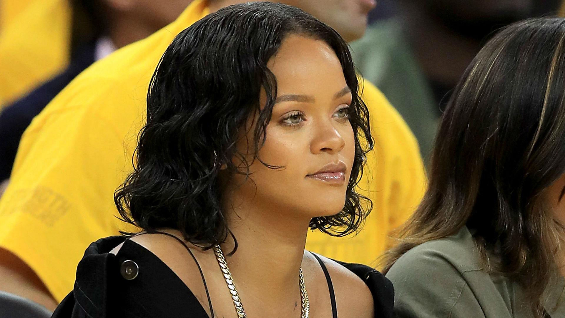 Rihanna's heckling and dabbing steals National Basketball Association finals spotlight