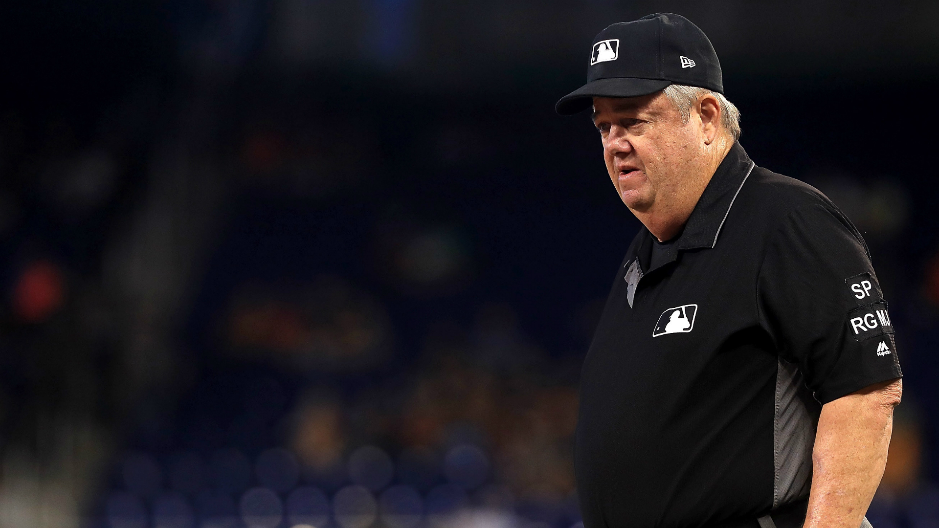 Major league umpires wear wristbands to protest 'escalating verbal attacks' from players