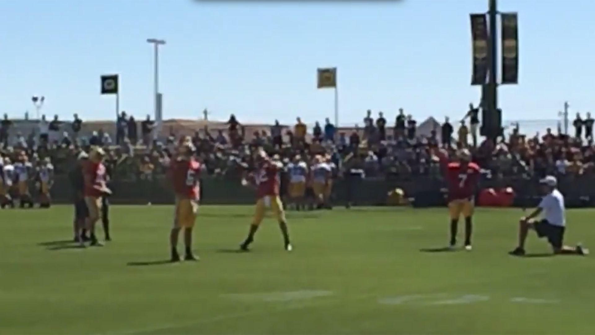 Aaron Rodgers launches football into net from midfield