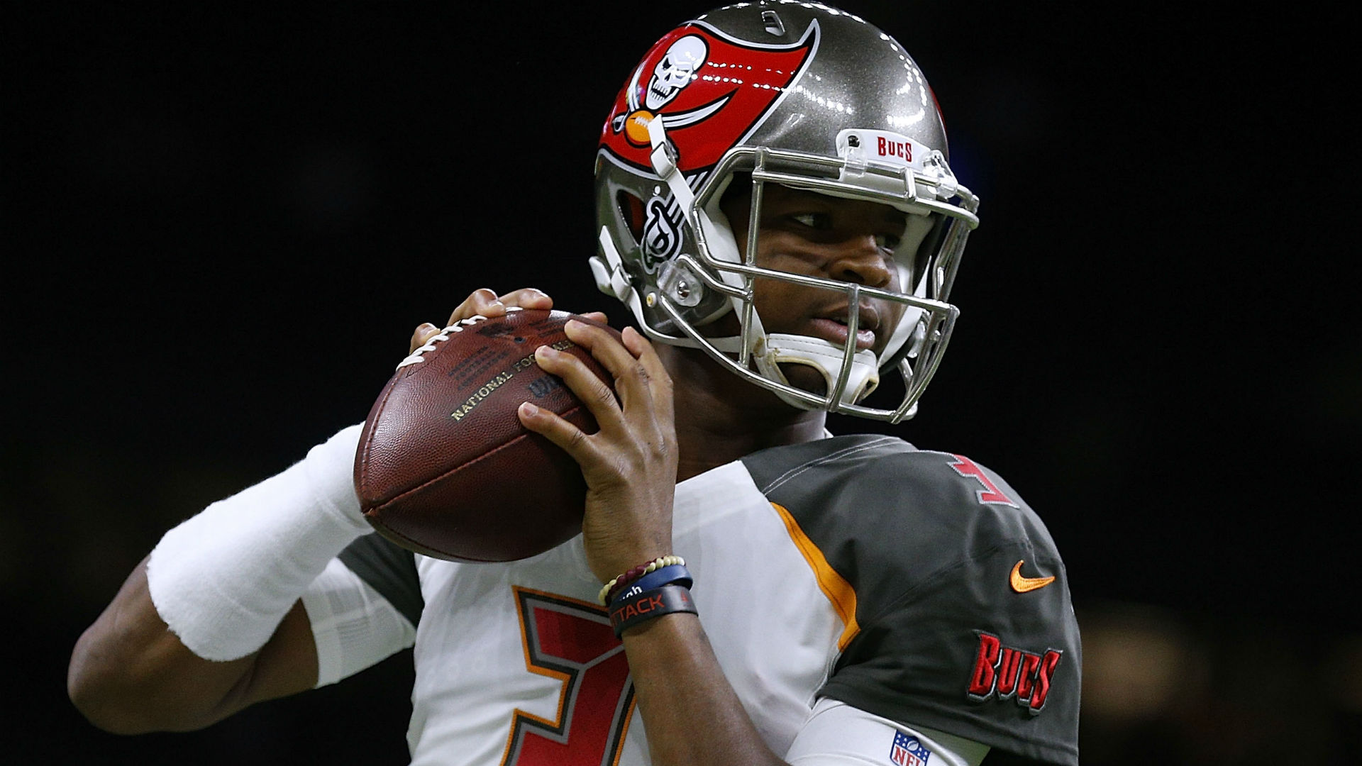 Jameis Winston on sideline in second half after hard hits by Saints