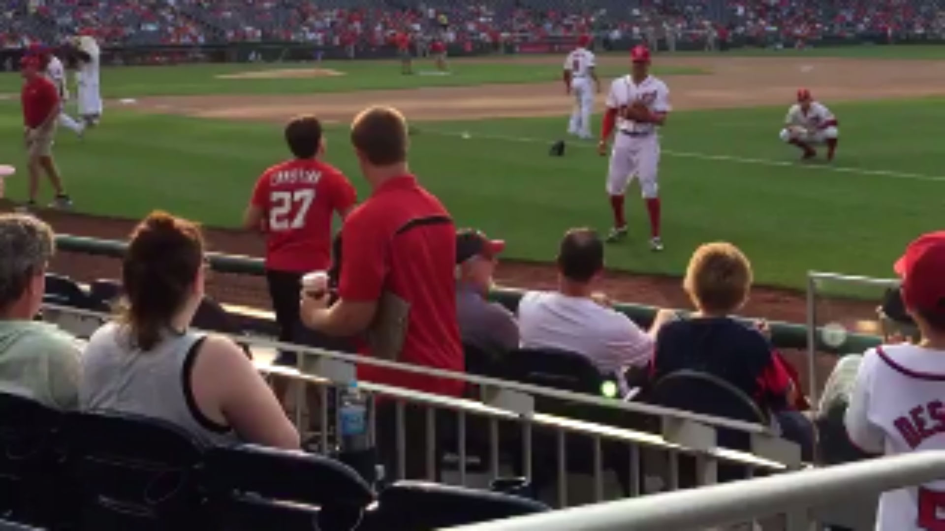 Washington Nationals shortstop Ian Desmond plays catch with a fan with a disability