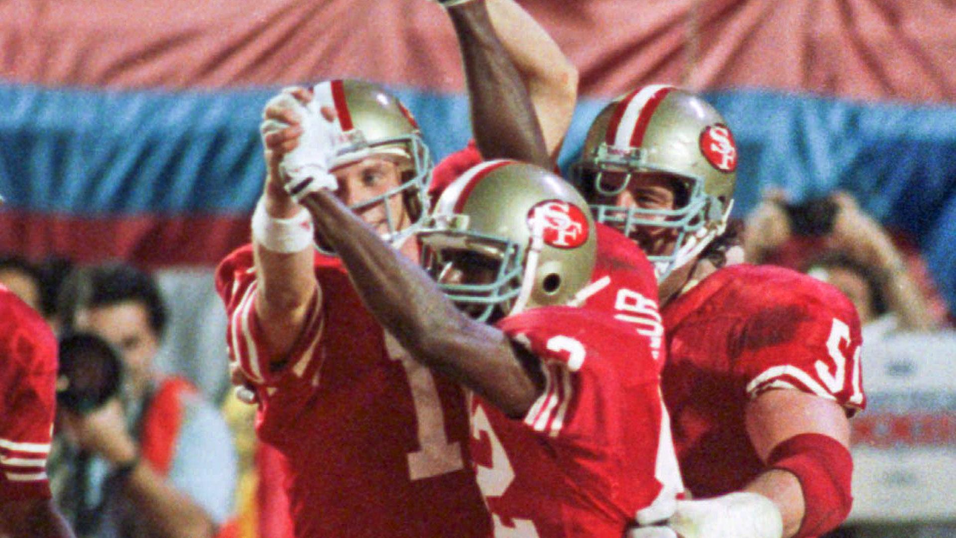 Joe Montana and John Taylor-013114-AP-FTR.jpg
