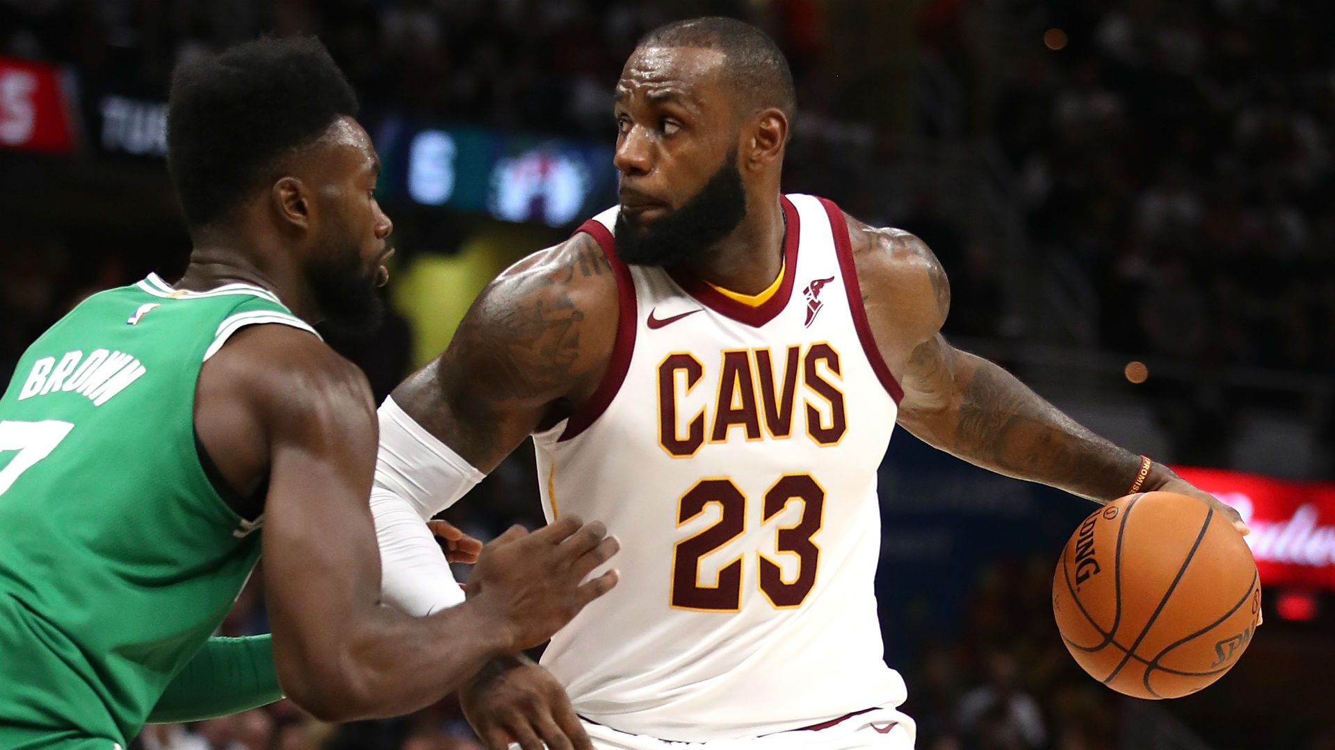 Cavs forward Le Bron James defended by Celtics forward Jaylen Brown