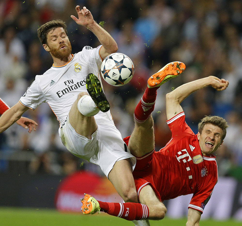 Xabi Alonso and Thomas Mueller