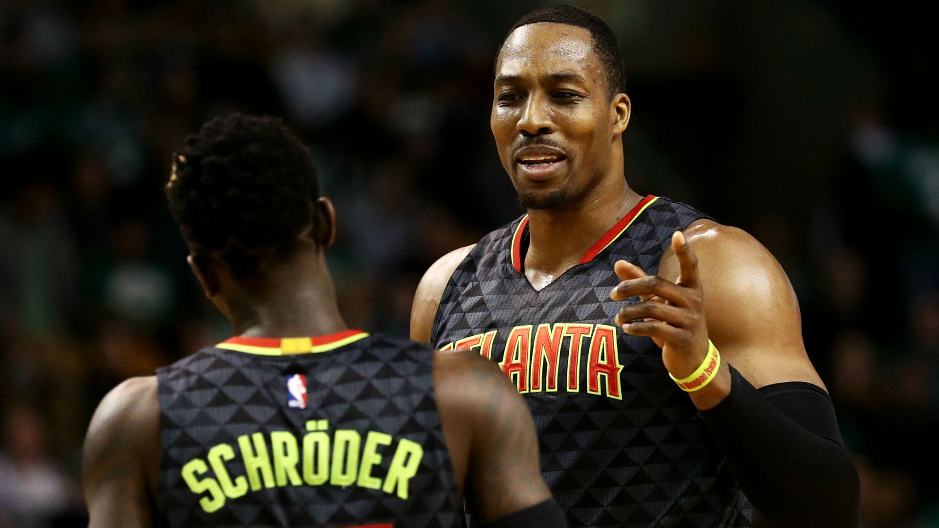 Dennis Schroder has heated exchange with Dwight Howard, coach Mike Budenholzer