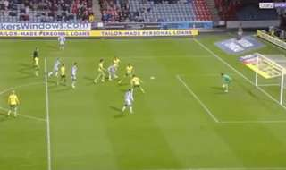Caltex Socceroos midfielder Aaron Mooy scored for Huddersfield in their 3-0 win over Norwich City.